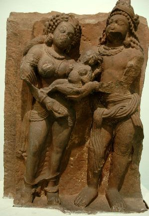 Devaki and Vasudev holding the Divine Baby, a 5th century CE sculpture, Gupta Era.